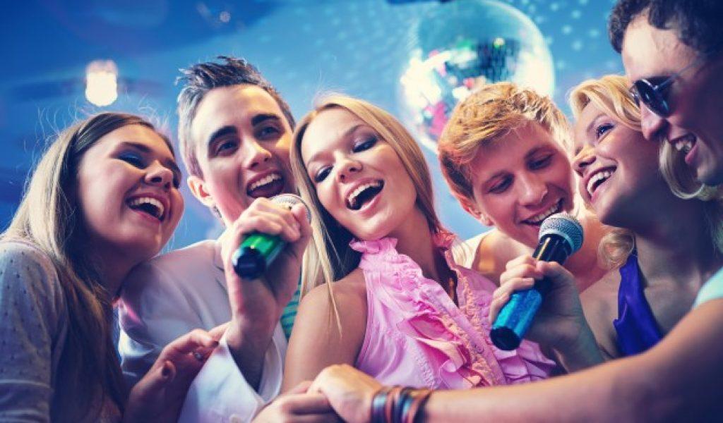 happy-friends-singing-karaoke-together_1098-1623