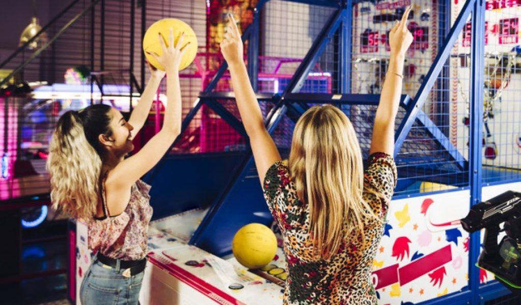 happy-women-playing-basketball-arcade-game_23-2148253109