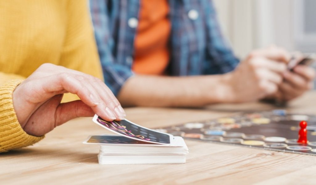people-playing-business-board-game-wooden-desk_23-2148152756
